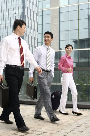 Business people chatting while walking Stock Photo - 4194749