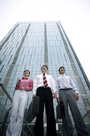 Business people standing in front of a building