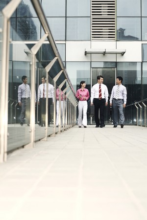 Business people chatting while walking back Stock Photo - 4194671