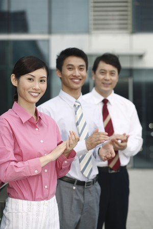 Business people clapping hands photo