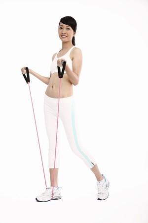Woman using exercise band Stock Photo - 4194523