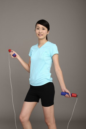 Woman using skipping rope Stock Photo - 4194634