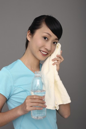 contentment: Woman wiping sweat after exercising