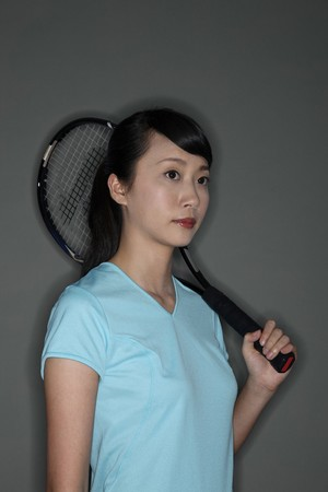 tennis racket: Woman holding tennis racket