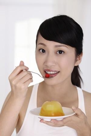 sweetness: Woman eating pudding