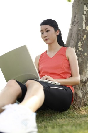 Woman using laptop in the park photo