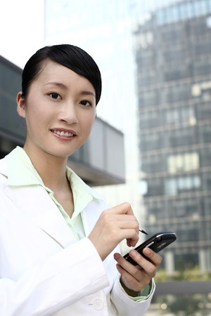 contentment: Businesswoman using pda