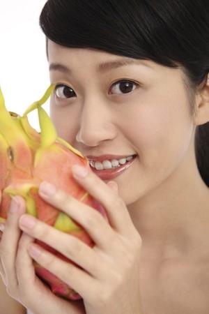 Woman holding dragon fruit Stock Photo - 4194596