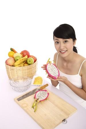 Woman holding dragon fruit photo