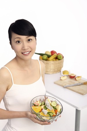 Woman holding a bowl of fruit salad Stock Photo - 4194495