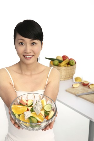 Woman holding a bowl of fruit salad Stock Photo - 4194481