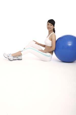 Woman leaning on fitness ball Stock Photo - 4194284