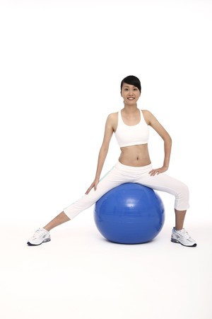 Woman exercising on fitness ball photo