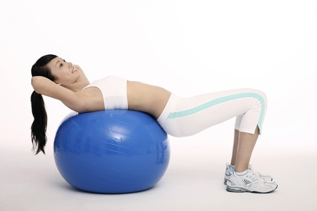 Woman exercising on fitness ball Stock Photo - 4194553