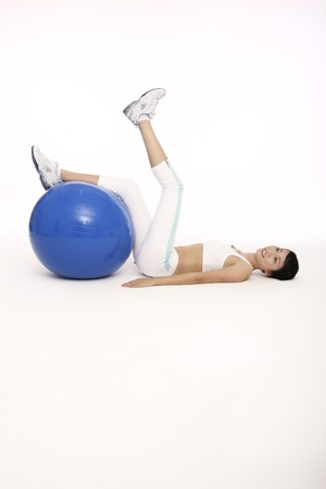 Woman exercising with fitness ball photo