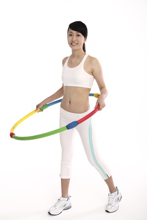 Woman exercising with hula hoop Stock Photo - 4194348