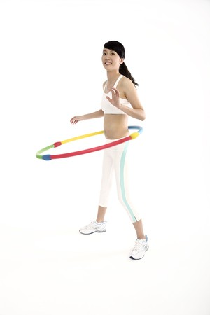 Woman exercising with hula hoop Stock Photo - 4194573