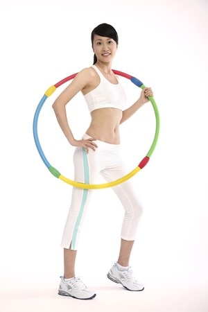 contentment: Woman exercising with hula hoop