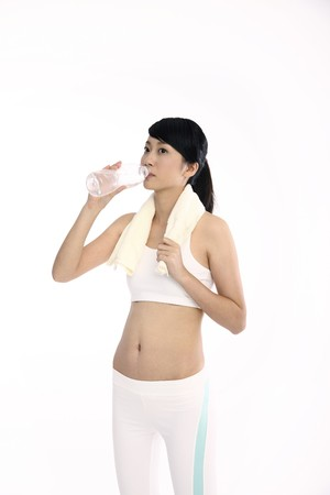 Woman drinking water after exercising photo