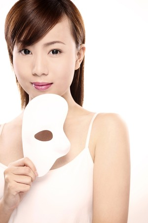 Woman holding a mask Stock Photo