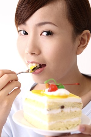 Woman eating cake 免版税图像