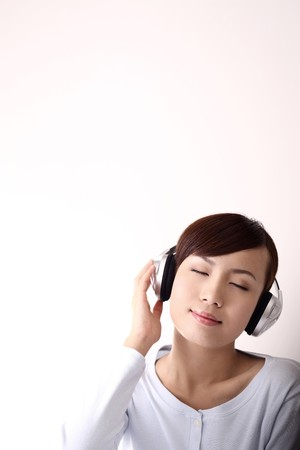 listening to people: Woman listening to headphones