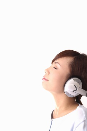 Woman listening to headphones photo