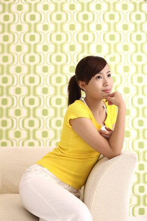 Woman smiling and contemplating Stock Photo