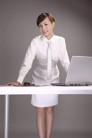 Businesswoman in formal wear smiling photo