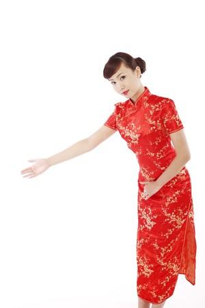 extending: Woman wearing cheongsam extending her arm