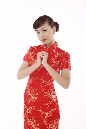 Woman wearing cheongsam greeting Happy Chinese New Year Stock Photo