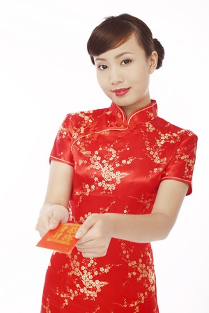 Woman wearing cheongsam giving red packet photo