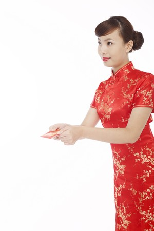 red packet: Woman wearing cheongsam giving red packet Stock Photo