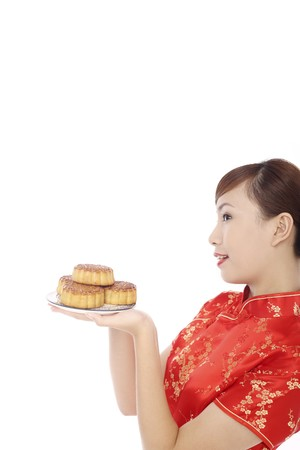 Woman wearing cheongsam holding a plate of mooncakes Stock Photo - 4194567