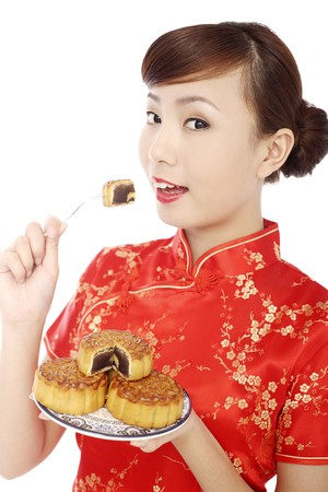 Woman wearing cheongsam eating mooncake Stock Photo - 4194673