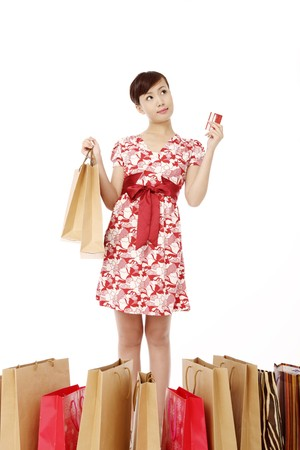 Woman holding a credit card and shopping bags photo