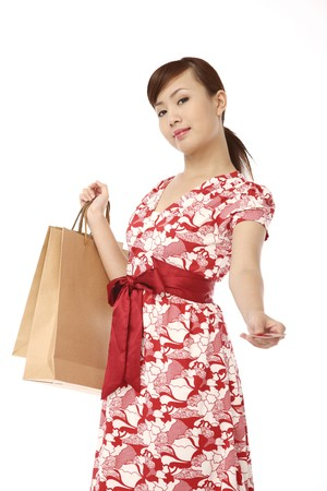 Woman paying with a credit card, shopping bags in the other hand photo