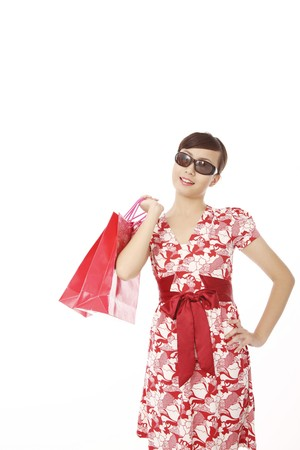 Woman wearing sunglasses holding shopping bags Stock Photo - 4194246