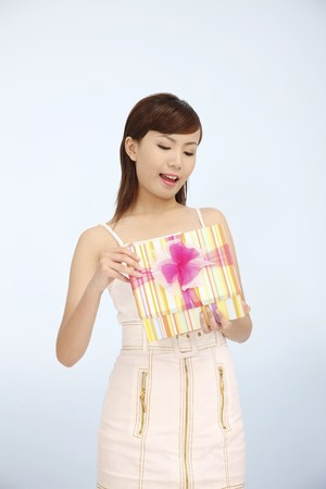 Woman opening a gift Stock Photo - 4194467