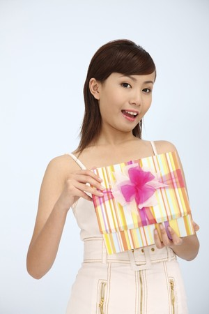 Woman opening a gift photo