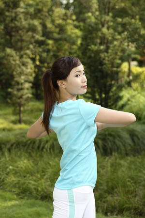 Woman exercising in the park Stock Photo - 4194709