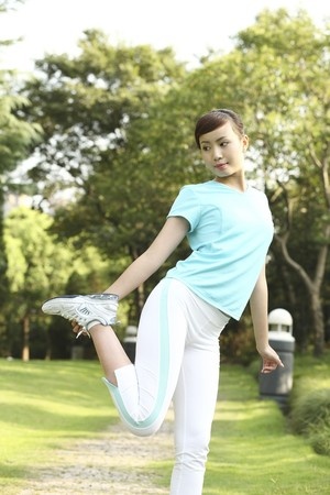contentment: Woman exercising in the park