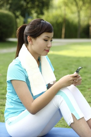 Woman text messaging on the phone photo