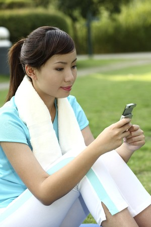 Woman text messaging on the phone Stock Photo - 4194652