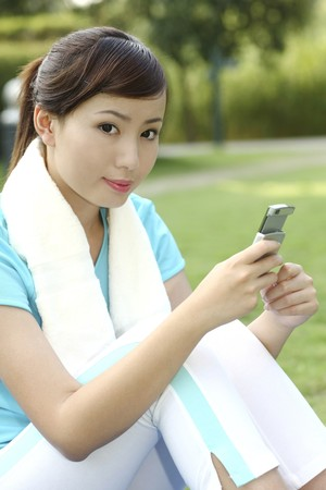 Woman text messaging on the phone Stock Photo - 4194595
