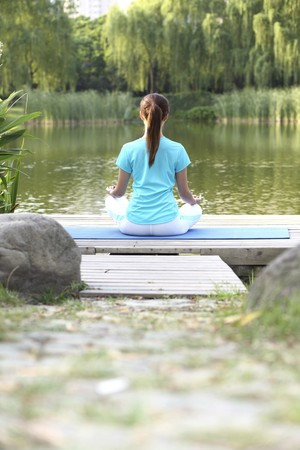 Woman meditating in the park Stock Photo - 4194614