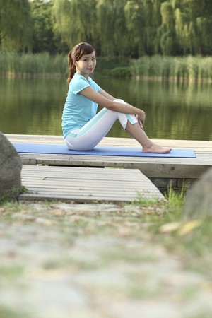 Woman relaxing in the park Stock Photo - 4194315