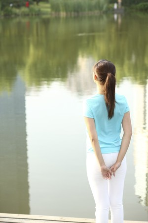 Woman standing by the lake Stock Photo - 4194439