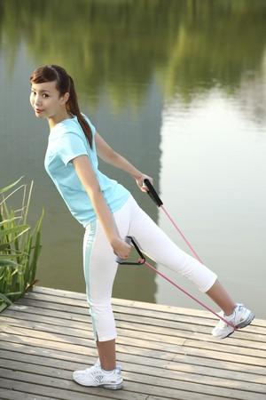 Woman using exercise band photo