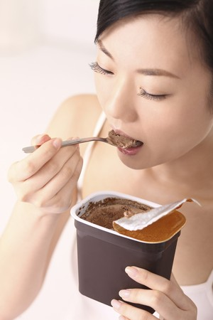 Woman eating ice-cream photo